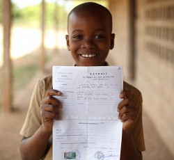 2011, Bondoukou, Cote d'Ivoire: Diomande Noel Berole, 10, holds his birth certificate, outside his school in Bondoukou, Cote d'Ivoire. As many as three out of every 10 births in the West African nation go unregistered. Without birth certificates these children may be refused an education. Credit: UNICEF