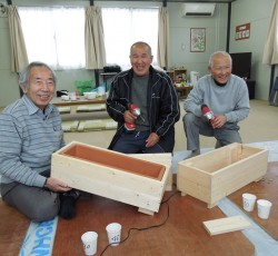 8 March 2012, Ishinomaki, Japan: Residents in temporary houses build flower boxes, together with Peace Boat volunteers. Credit: Masaki Watabe/ OCHA