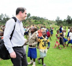 3 Oct 2012: OCHA Operations Director John Ging with displaced children in Kitsumbiro, North Kivu. Credit: OCHA/Imane Cherif
