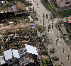 "22 May 2008, Bebaye Township, Myanmar: An aerial view of the damage caused by Cyclone ""Nargis"" in the Ayeyarwady delta region, along the shores of the Andaman Sea. Credit: UN Photo/Evan Schneider"