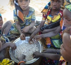 Young girls eating a mid-day meal at at World Food Programme school feeding centre in Guidam Makadam, Maradai Region, Niger.