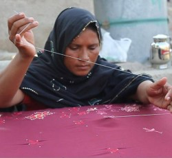 Perveen Majeed embroidering handicrafts. Credit: IFC