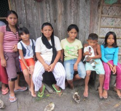 Kaligan with some of her children outside their home in Damablak, Maguindanao. Credit: OCHA