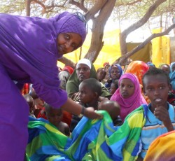 13 August 2012, Somalia: Mama Amina with children. Credit: OCHA