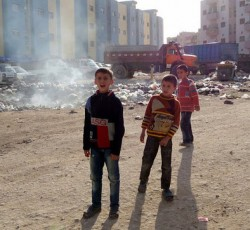 Oct 2012, Syria: Garbage disposal is a major problem for the people living in the housing complex in Adra. There is no electricity, running water or sewage system, and even windows and doors are incomplete. Credit: OCHA/ Parker