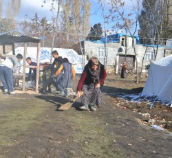 Canan Akyil sweeping outside of her UNHCR tent funded by CERF in Van, Turkey, Credit: UN CERF